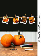 Pumpkins on school desk  in classroom