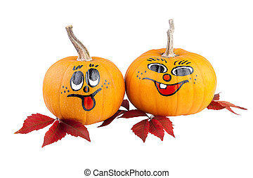 Pumpkins with autumn leaves isolated on white