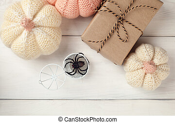 pumpkins with gifts o on white wooden background for Halloween Holiday, rustic, copy space