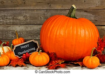 Pumpkins with Happy Thanksgiving chalkboard tag