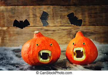 Pumpkins with Vampires teeth on a wood background. toning....