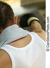 punching workout - male boxer doing punching workout outdoor