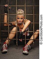 Punk girl behind bars