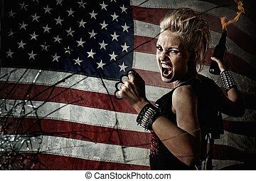 Punk girl behind broken glass.