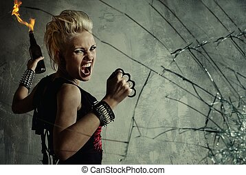 Punk girl behind broken glass