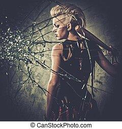 Punk girl behind broken glass with a baseball bat
