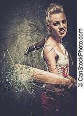 Punk girl breaking glass with a baseball bat