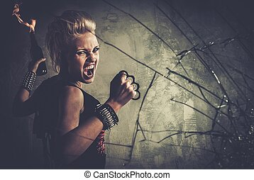 Punk girl with brass knuckles and Molotov cocktail