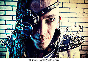 punk science - Portrait of a steampunk man with a mechanical...