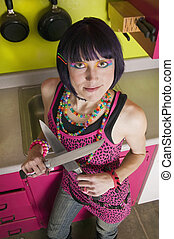 Punk woman in a colorful kitchen