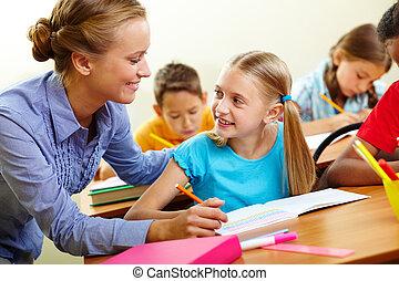 Pupil and teacher - Portrait of smart girl and her teacher...