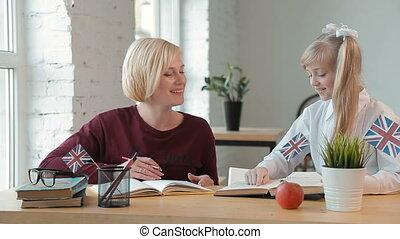 Pupil Asks for Help - Joyful pupil asking the teacher for...