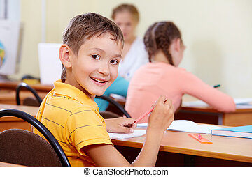 Pupil at workplace - Portrait of smart lad at workplace with...