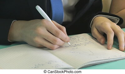 Pupil decides the task in a notebook in math - The pupil...