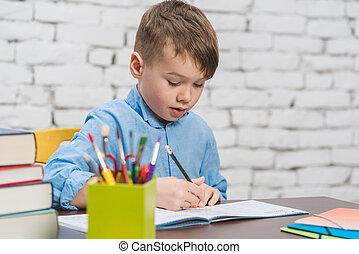 Pupil doing homework having an idea