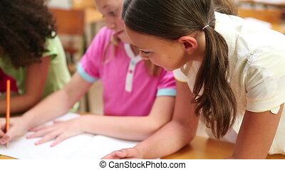 Pupil helping a classmate