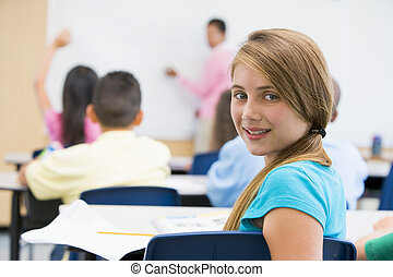 Pupil in elementary school classroom - Female pupil in...