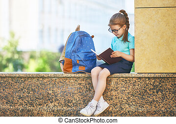 Girl with backpack - Pupil of primary school with book in...