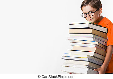 Pupil - Photo of clever preschooler holding heavy pile of...