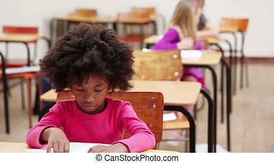 Pupil sitting at a table in the classroom