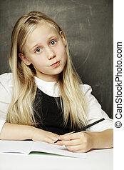 Pupil - small cute girl in school uniform