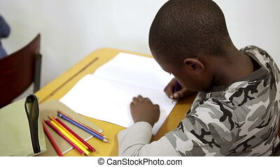 Pupil using coloring pens in the classroom