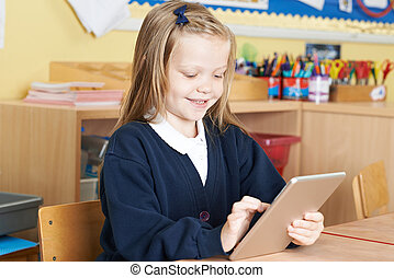 Pupil With Digital Tablet At School
