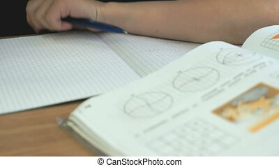 Pupil writes the text in a notebook on the lesson