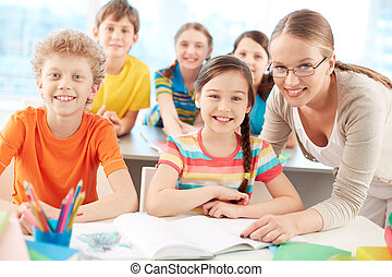 Pupils and teacher - Portrait of diligent schoolkids and...