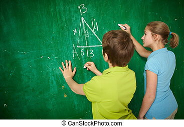 Pupils by blackboard