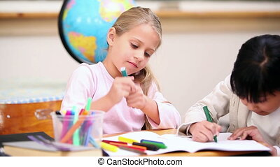 Pupils coloring in the classroom