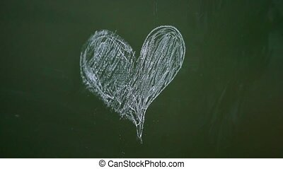 Pupils in school draw heart at chalk Board. Love and...