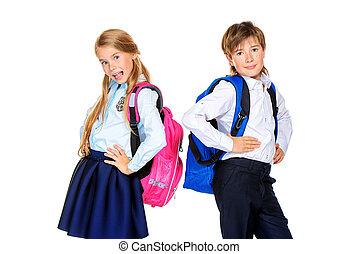 pupils in school uniform - School fashion. Two cute children...