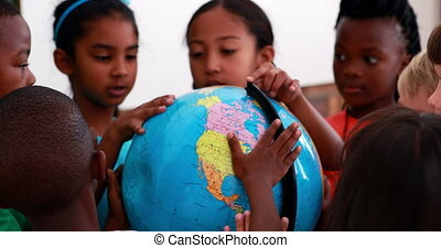 Pupils looking at the globe