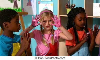 Pupils painting with their hands