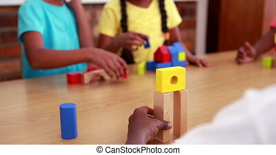 Pupils playing with building blocks