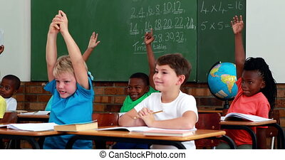 Pupils raising their hands