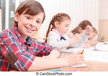 Pupils studding side by sides - Ingenuous smile. Smiling...
