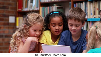 Pupils using the tablet pc together in the library in...