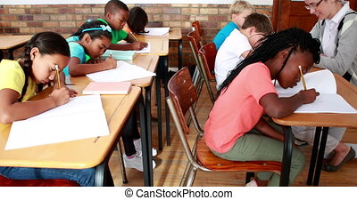 Pupils working hard during class