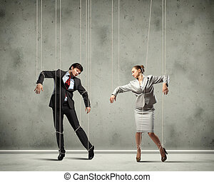 Puppet businesspeople - Image of businesspeople hanging on...