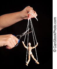 Puppet freedom - Hand cutting the strings of a puppet, ...