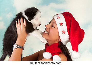 Puppy and santa girl