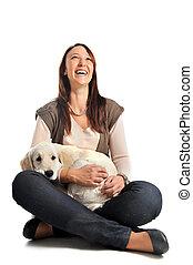 puppy golden retriever and girl