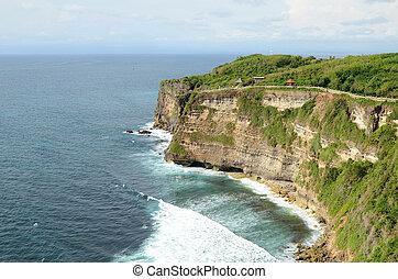 Pura Luhur Uluwatu temple in Bali, Indonesia with cliff with...