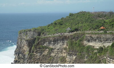 Pura Luhur Uluwatu, travelling from high cliff towards the...