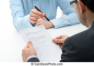 purchase agreement for a house - Man signs purchase...