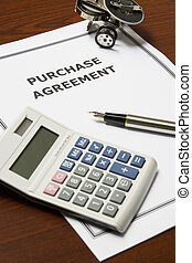 Image of a purchase agreement on an office table.