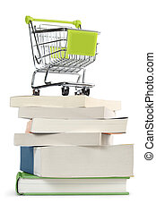 purchase books - shopping cart on top of a stack of books