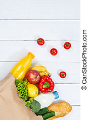 Purchase food purchases fruits and vegetables copyspace copy space paper bag portrait format wooden board